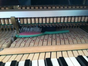 A hair brush found inside a piano